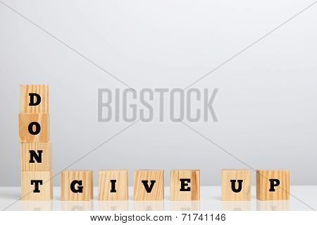 Dont Give Up Spelled In Letter Blocks