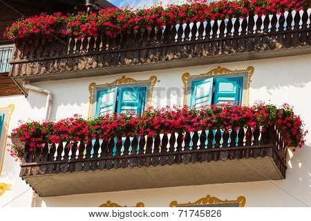 Traditional Alpine Houses With Flowers On Balcony, Cortina D'ampezzo, Dolomites Mountains, Italy