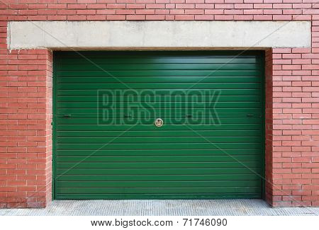 Green Metal Garage Gate In Red Brick Wall, Background Texture