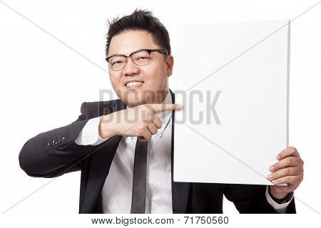 Asian Businessman Point To A Vertical Blank Sign And Smile