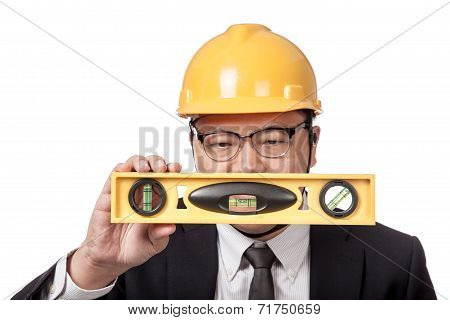 Asian Businessman Look At A Spirit Level