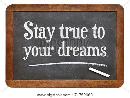 stay true to your dreams - a motivational phrase on a vintage slate blackboard