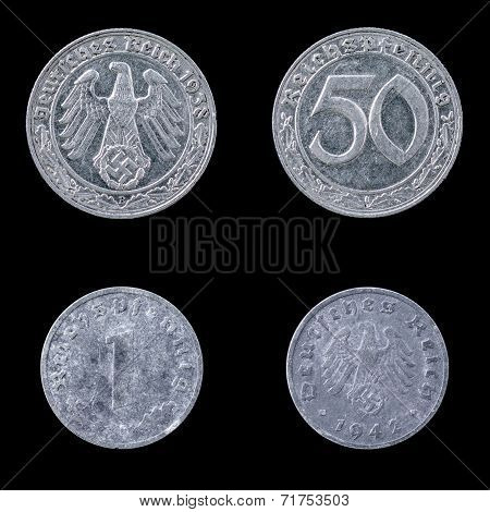 Two German Coins on a Black Background.
