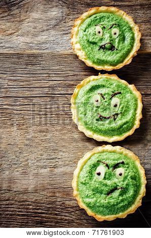Tartlets With Spinach Cream For Halloween In The Form Of A Monster For Kids