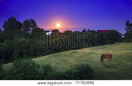 Moon rising over farmland in Kentucky