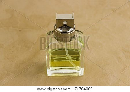 Awesome light greenish colour perfume bottle on an isolated background