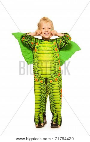 Blond boy in dragon costume full height portrait