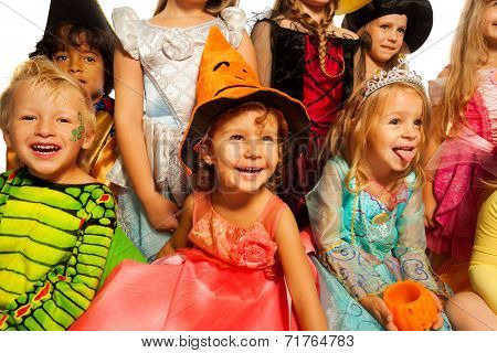 Many happy kids in Halloween costumes