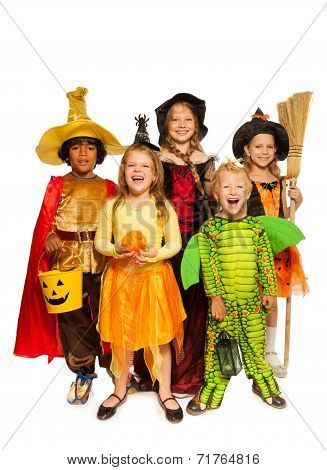 Kids with Halloween attributes in stage costumes