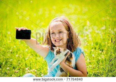 Selfie child and cat