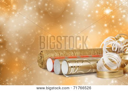 Rolls Of Multicolored Wrapping Paper For Gifts With A Streamer On A Beautiful Bright Background