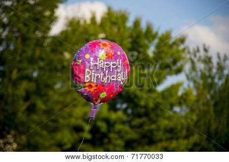 Happy birthday Balloons flying outdoors