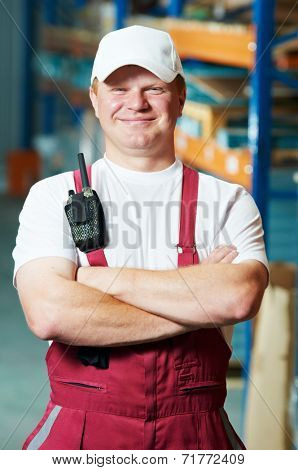 young warehouse worker portrait in uniform in front of modern storehouse shelves