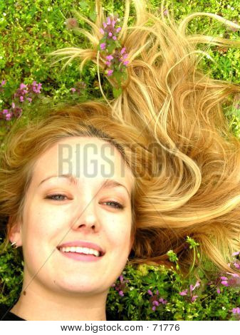 Blond Woman In Grass Headshot