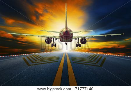 Passenger Jet Plane Preparing To Take Off From Airport Runways With Motion Blur Against Beautiful Du