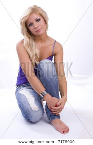 Blond Woman In Jeans With Smoky Eyes Make-up