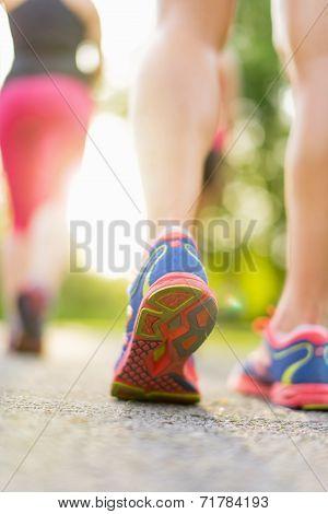 detail of legs during jogging