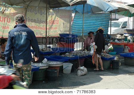 Open-Air Seafood Shop at Street Market