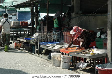 Fish Mongers at Open-Air Fresh Market