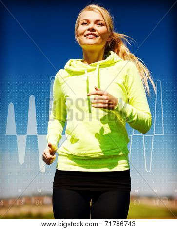 fitness, sport, training and lifestyle concept - smiling female runner jogging outdoors