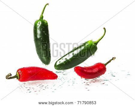 wet green and red hot pepper