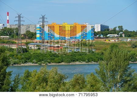 NOVOSIBIRSK, RUSSIA - AUGUST 31, 2014: New residential building on the left bank of Ob river. One million of square meters of housing will be built in the city in this year
