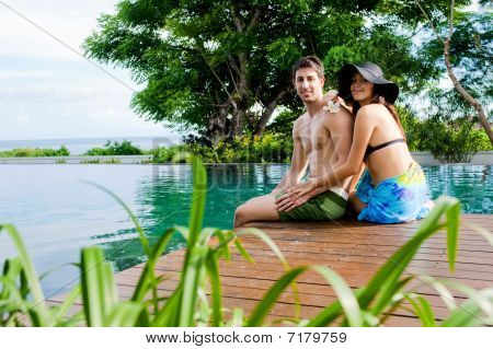 Couple Relaxing By Pool