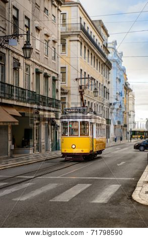 Vintage yellow tramway in the streets of Lisbon