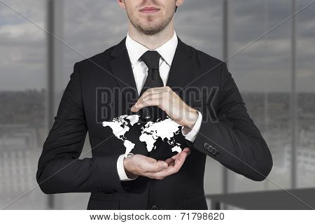 Businessman Protecting World Map