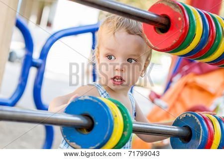 Funny Toddler Boy On The Playground