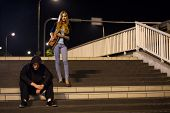 stock photo of mobsters  - Woman on railway station at night horizontal - JPG