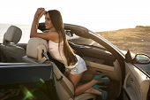 Постер, плакат: Sexy Girl With Dark Hair Posing In Luxury Cabriolet