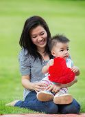 stock photo of mother baby nature  - Beautiful asia Mother And Baby outdoors - JPG