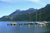 stock photo of annecy  - boats moored on Lake Annecy in the French Alps - JPG