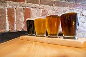 picture of four  - Flight of Four Beers for Tasting in a Pub - JPG