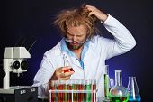 stock photo of mad scientist  - Crazy scientist working in laboratory - JPG