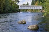 stock photo of mckenzie  - The Goodpasture covered bridge in Lane County Oregon is one of the most well - JPG