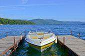 stock photo of ski boat  - A boat tied up at a dock on Lake Jocassee in South Carolina - JPG