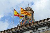 picture of minister  - Flag of Spain and Flag of Catalonia at the top of Palau de la Generalitat de Catalunya - JPG