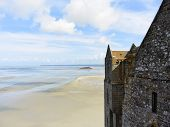 stock photo of mont saint michel  - scenic with Tombelaine island and tidal bay at low tide and wall of mont saint - JPG