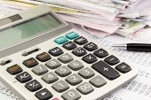 stock photo of summary  - close up calculator on financial summary report - JPG
