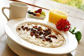 image of orange-juice  - Breakfast of freshly prepared oatmeal topped with raisins - JPG