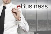 pic of ebusiness  - businessman in office writing ebusiness in the air - JPG