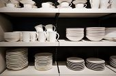 picture of crockery  - White crockery on shelves in a shop - JPG