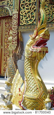 Gold Dragon with wavy tail.
