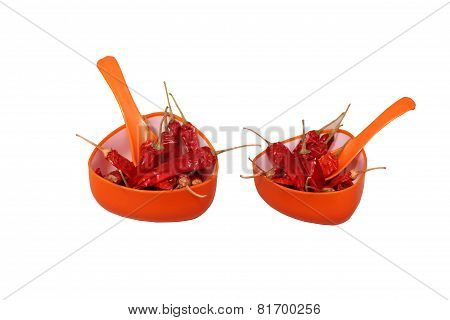Dried Reddish Spicy Chilly in orange cup with spoon