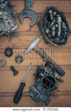 Carburetors for a car engine with tools