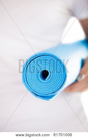 Close Up: Folded Blue Yoga Mat In Woman Hands