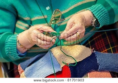 Grandmother Knits Up The Wool