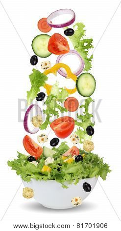 Falling Ingredients For Green Salad In Bowl With Lettuce, Tomatoes, Onion And Olives
